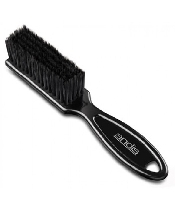 An image of Andis blade brush